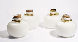 A set of four opaque glass and brass mounted pendant ceiling lights, 28cm diameter.