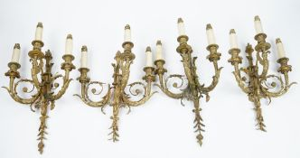 A set of four gilt-bronze three branch wall lights, of Louis XVI style,