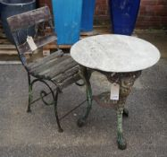An early 20th century cast iron garden table with associated white marble circular top,