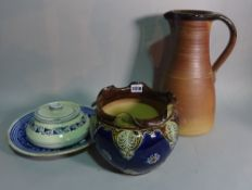 A Doulton jardinèire with blue glaze, 21cm high, a brown glaze studio pottery jug,