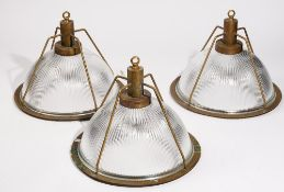 A set of three modern brass and holophane glass industrial ceiling lights, 34cm high (3).