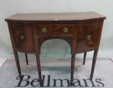A William IV mahogany bowfront sideboard on turned supports, 114cm wide x 91cm high.