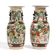 A pair of Chinese crackle glazed baluster vases, late 19th century, painted with battle scenes,