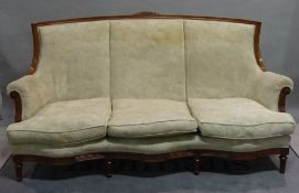 A Louis XVI style stained beech three piece suite comprising a serpentine sofa,