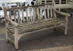 A modern hardwood garden bench 122cm wide x 84cm high.