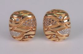 A pair of 18ct gold and diamond set earclips of rounded rectangular abstract design,