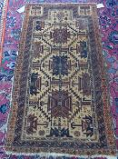 A Beluchistan prayer rug, the pale caramel mehrab with three stylised medallions,