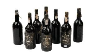 Eight bottles of Dow's 1977 vintage Port.
