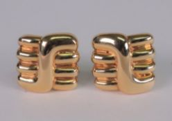 A pair of yellow gold square earclips of abstract Chinese symbol design, detailed 18k,