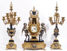 An Louis XVI style gilt metal mounted clock garniture, 20th century,