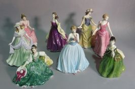 A group of eight Royal Doulton figurines, the largest 23cm high (8).