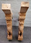 A pair of oak corner brackets relief carved with grotesque figures, 90cm wide x 94cm high, (2).