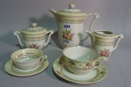 A Limoges floral decorated tea set, comprising 12 cups and saucers, coffee pot and sugar bowl,