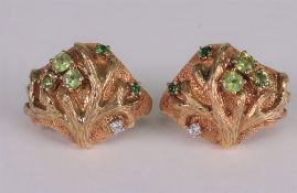A pair of 18ct white and yellow gold green gem and diamond set earclips of abstract textured tree
