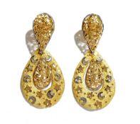 A pair of Al Zain gold pendant earrings, each with a pear shaped drop,