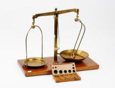A set of Maw Class B brass beam scales, on a wooden base, 50.