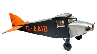 A scratch built model of an ABC Robin monoplane, finished in black and orange, 175cm long,