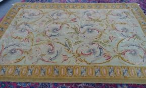 A modern Savonnerie-style carpet, the pale sage field with scrolling acanthus leaves,