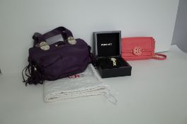 A Versace VJC purple leather twin handled handbag, with silver-tone hardware and applied tassels,