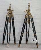 A pair of modern black painted wood and brass height adjustable tripod standard lamps,