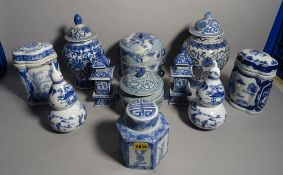 Modern Asian ceramics, including; a pair of vases and covers in the form of pagodas,