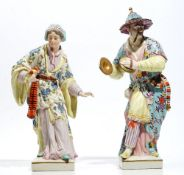 A pair of Continental porcelain figures of Malabar musicians, 20th century,