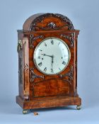 An early Victorian mahogany three train quarter striking bracket clock The arched case with canted