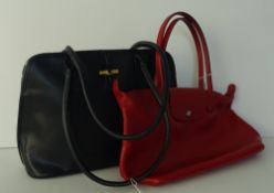 A Longchamp two handled navy leather bag,