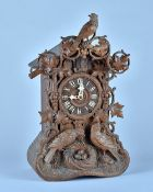 A German carved fruitwood 'Cuckoo' clock By Beha, Late 19th Century With carved cresting piece,