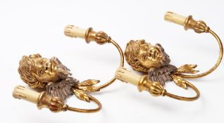 A pair of early 20th century gesso gilt metal and carved wood wall lights,