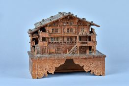 A charming Swiss fruitwood and softwood musical box in the form of a chalet Circa 1896 The musical