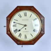 An octagonal mahogany and brass line inlaid mahogany Dial timepiece Mid 19th Century The 10in
