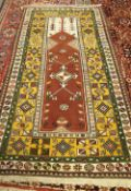 A Turkish prayer rug, the brown mehrab with a diamond to centre,
