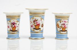 A garniture of three Ridgway porcelain spill vases, circa 1820,