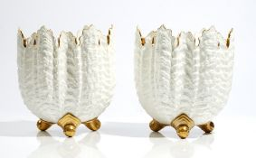 A pair of Coalport white and gilt bone china shell moulded jardinieres, late 19th century,