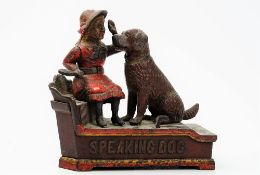 A polychrome painted cast iron automaton money box, detailed 'Speaking Dog Bank', 19.5cm wide.