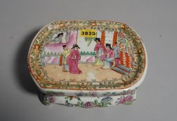 A modern Chinese famille rose decorated head rest, 21cm wide x 8cm high.