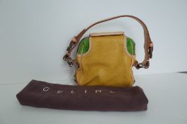 A Celine yellow and green leather handbag, the top opening bag,