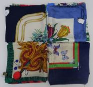 A collection of four Italian printed silk scarves,