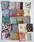 A collection of twenty Liberty of London printed silk head scarves,