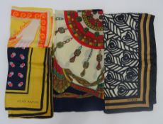 A collection of four designer silk scarves,
