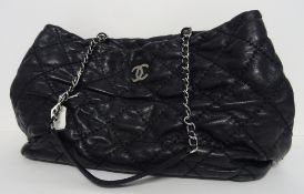 A Chanel black quilted leather tote bag, circa 2012-2013, with silver-tone hardware,
