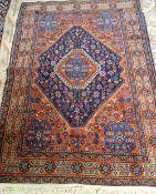 A Mahal rug, Persian, the indigo diamond field with a madder medallion,