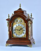 A late Victorian giltmetal-mounted mahogany quarter chiming bracket clock In the George III