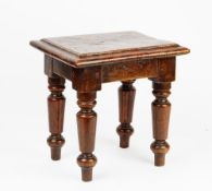 A Victorian pollard oak stool on turned supports, 34cm wide x 34cm high.