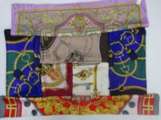 A collection of seven printed silk scarves,