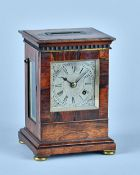 A William IV rosewood mantel timepiece The top with inset flush carrying handle,