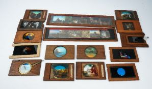 A collection of approximately fifty coloured magic lantern slides,