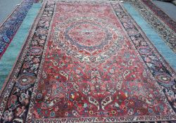 A Mahal carpet, Persian, the madder field with a bold rosette medallion,