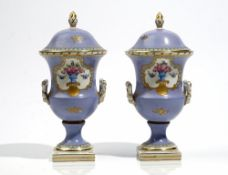 A pair of small French porcelain lilac-ground two-handled vases and covers, circa 1900,